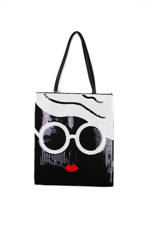 BLACK , WHITE AND A TOUCH OF RED  BAG WITH BLACK HANDLE ON TOP & SUNGLASSES