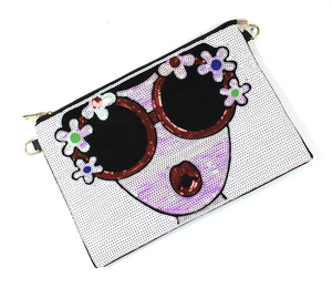 Sequined black small purse with a picture of a face with sunglasses and flowers on glass