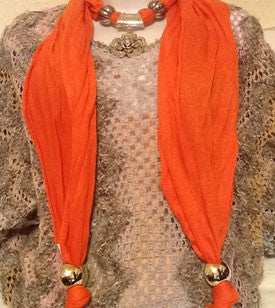 Orange Scarf with Silver Flower Pendant