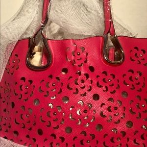 Red bag with small purse inside.