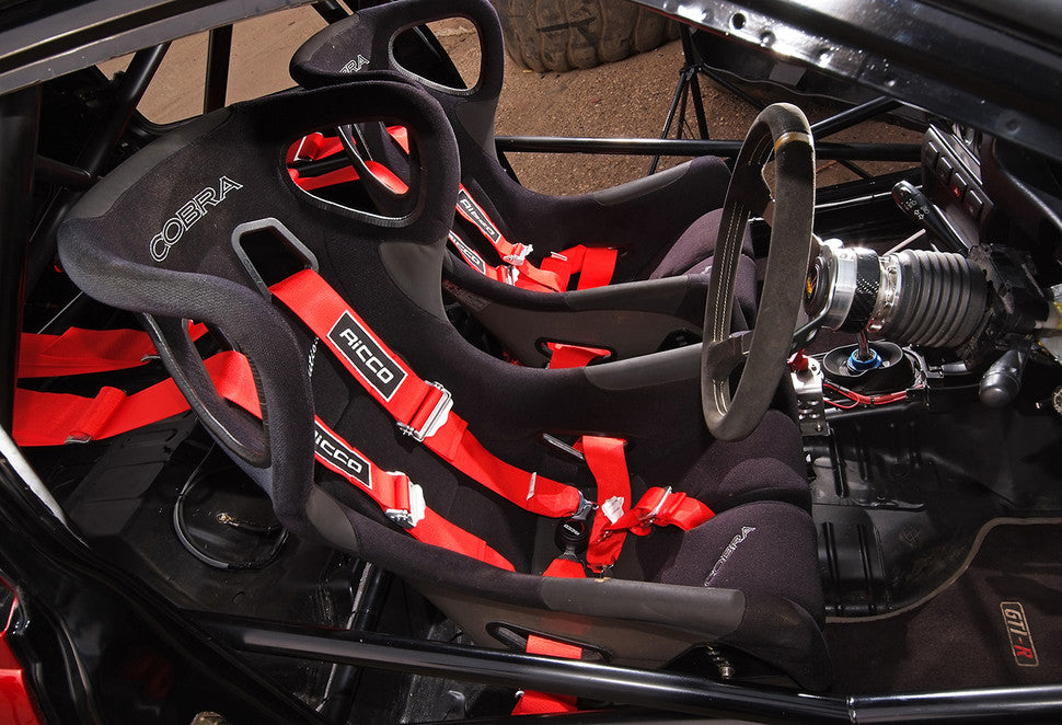 Bucket racing seat and harness in rally car