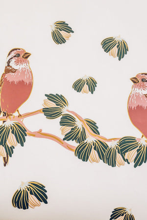 red birds on branches wallpaper