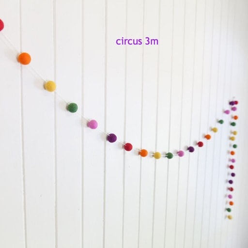 felt garland of round balls, colour circus, shades of orange, yellow, green, pink, purple, red