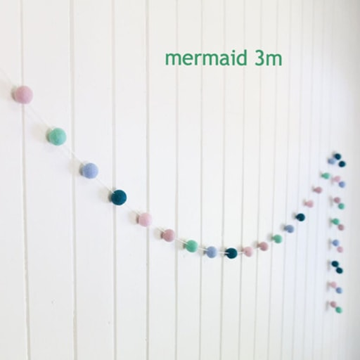 felt garland of round balls, colour mermaid, shades of pale pink, pale teal, pale blue, dark teal, pale coral