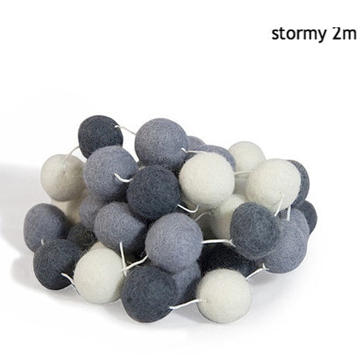 felt garland of round balls, colour stormy, shades of white, pale grey, grey, dark grey
