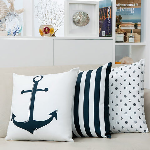 Tap into the nautical look with this lovely anchor cushion. Featuring a dark blue anchor design on both sides, this cushion adds a calm, coastal touch to any living space, indoors and outdoors.
