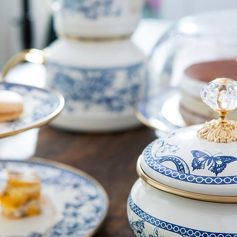 A decorative option for storing and serving sugar, chocolate, sweets and other food. Timeless blue and white style. Elegant craftsmanship with crystal and gold coloured lid.  Style it with the matching tea pot set, cake & cookie stand and sugar holder to custom make your set.