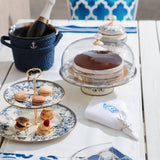 Ideal for showcasing cookies, cakes, cupcakes, and your favorite deserts, this timeless blue and white cake stand with gold color finishings adds an elegant touch to your tableware. Style it with the matching teapot set, cake stand, and sugar holder to create your own set.