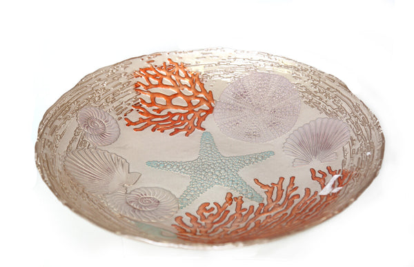 Create a stylish centerpiece with this giant piece-of-art glass bowl. Featuring stunning coral and shellfish details with golden touches embossed on the glass, this colorful bowl is an awe-inspiring addition to your table setting. It also serves as a stylish platter to serve fruits, chips, and more