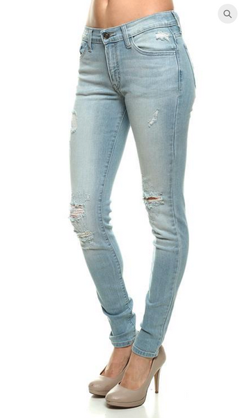 Light Distressed Skinny Jeans