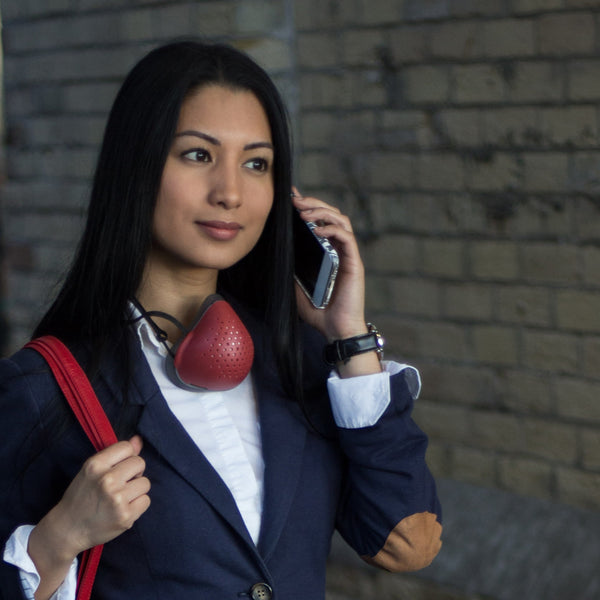 Businesswoman wearing O2 Curve with red shell.