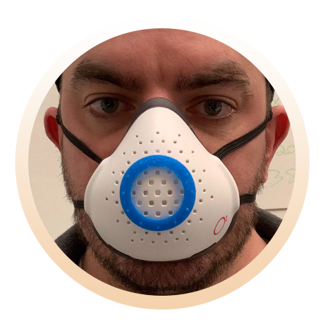 Man wearing O2 Curve with O2 Surgical Mask Adapter.