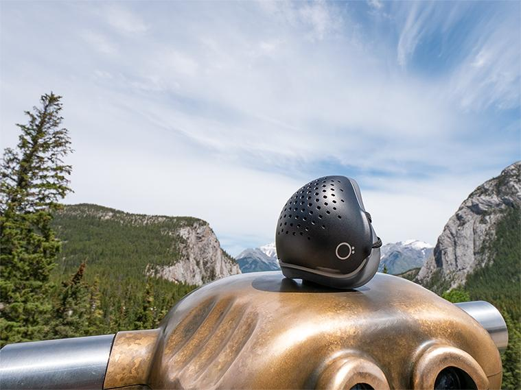 O2 Curve respirator sitting on rock in front of scenic view.