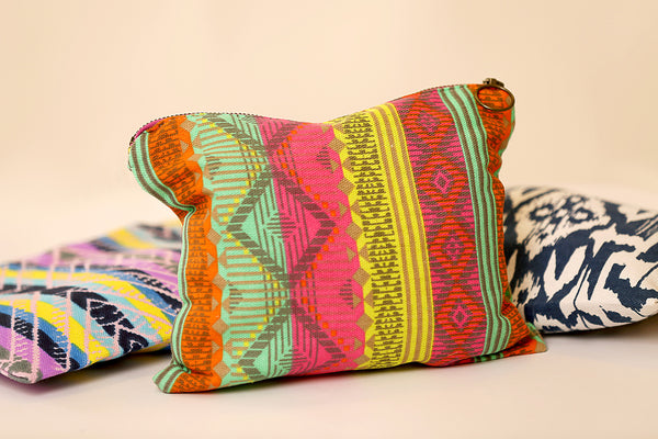 Multi colored canvas clutch bag