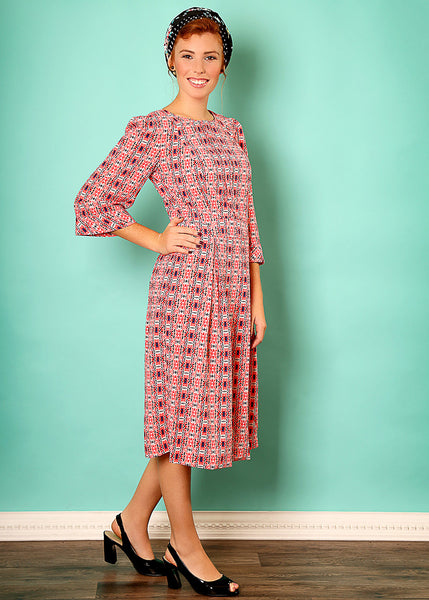 Modest pink midi dress with print
