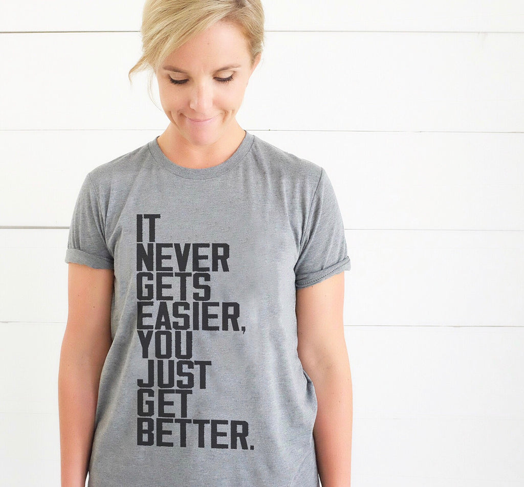 IT NEVER GETS EASIER, YOU JUST GET BETTER ADULT T-SHIRT/TANK TOP