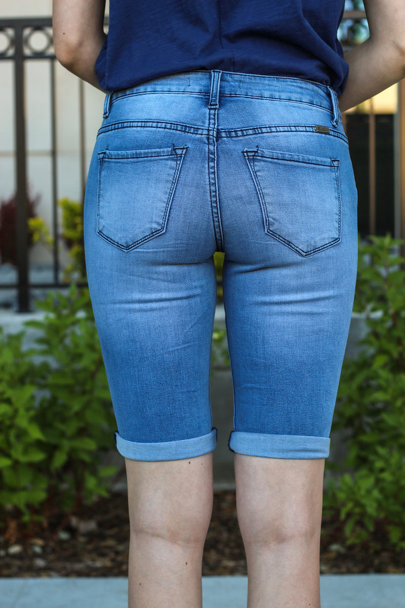 "Kan Can Jeans Collection: Core Style Style Name: Melody  Color: Medium Light Wash Cut: Bermudas, 11"" Inseam Rise: Mid-Rise, 8.5"" Front Rise Material: 54% COTTON 34% RAYON 10% POLYESTER 2% SPANDEX Stitching: Classic Fly: Zip Style #: KC6110M"