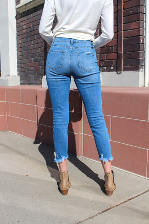 "Kan Can Jeans Collection: Core Style Color: Medium Wash Cut: Ankle Skinny, 27"" Inseam Rise: High-Rise, 9.5"" Front Rise 98% COTTON / 2% SPANDEX Stitching: Classic Fly: Exposed Button Style #: KC8577M  Contact us for any additional measurements or sizing."