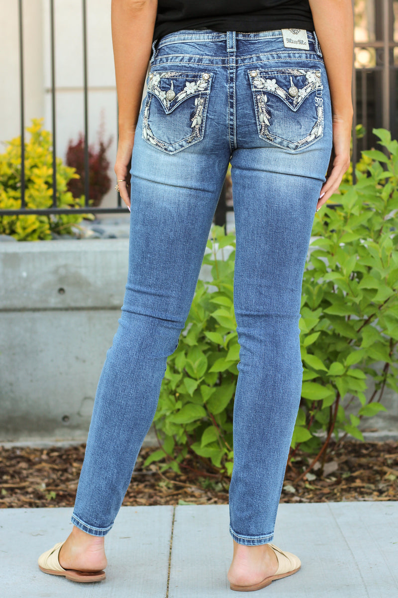 "Miss Me Jeans Collection: Summer 2020 Name: Floral Border Skinny Color: Medium Wash Cut: Skinny, 30"" Inseam Rise: Mid Rise, 8.75"" Front Rise 92% Cotton 6% Polyester 2% Elastane Stitching: Classic Fly: Zipper Style #: M3527S"
