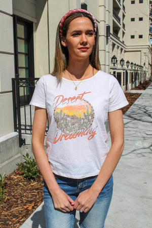 Desert Dreaming Top By Miss Me  Dreaming all summer long for sunny days and flip flops. Wear this tee with your favorite shorts for any summer occasion.  Collection: Spring 2020 Criss Cross Back Cream Material: 100% COTTON  Style #: MJT0027S