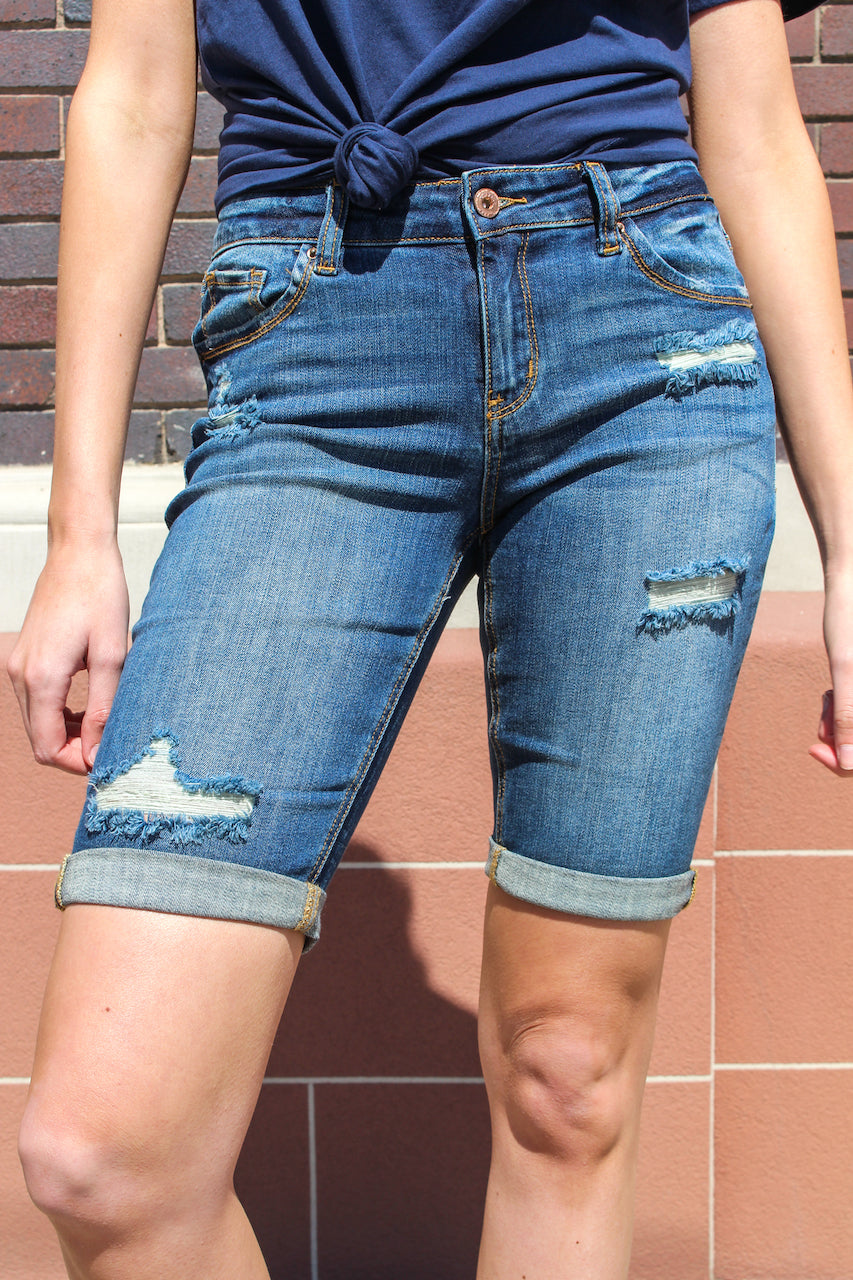 "Distressed Bermuda Shorts from A2 Jeans by Special A  Collection: Spring 2020 Bermuda Shorts Mid Rise waist, 8.5"" Front Rise Shorts, 12.5"" Inseam Medium Wash Material: 98% COTTON 2% Elastane Stitching: Classic Fly: Zipper Style #: IS5638D  Contact us for any additional measurements or sizing.  Small/1-3 Medium/ 5-9 Large/9-13"