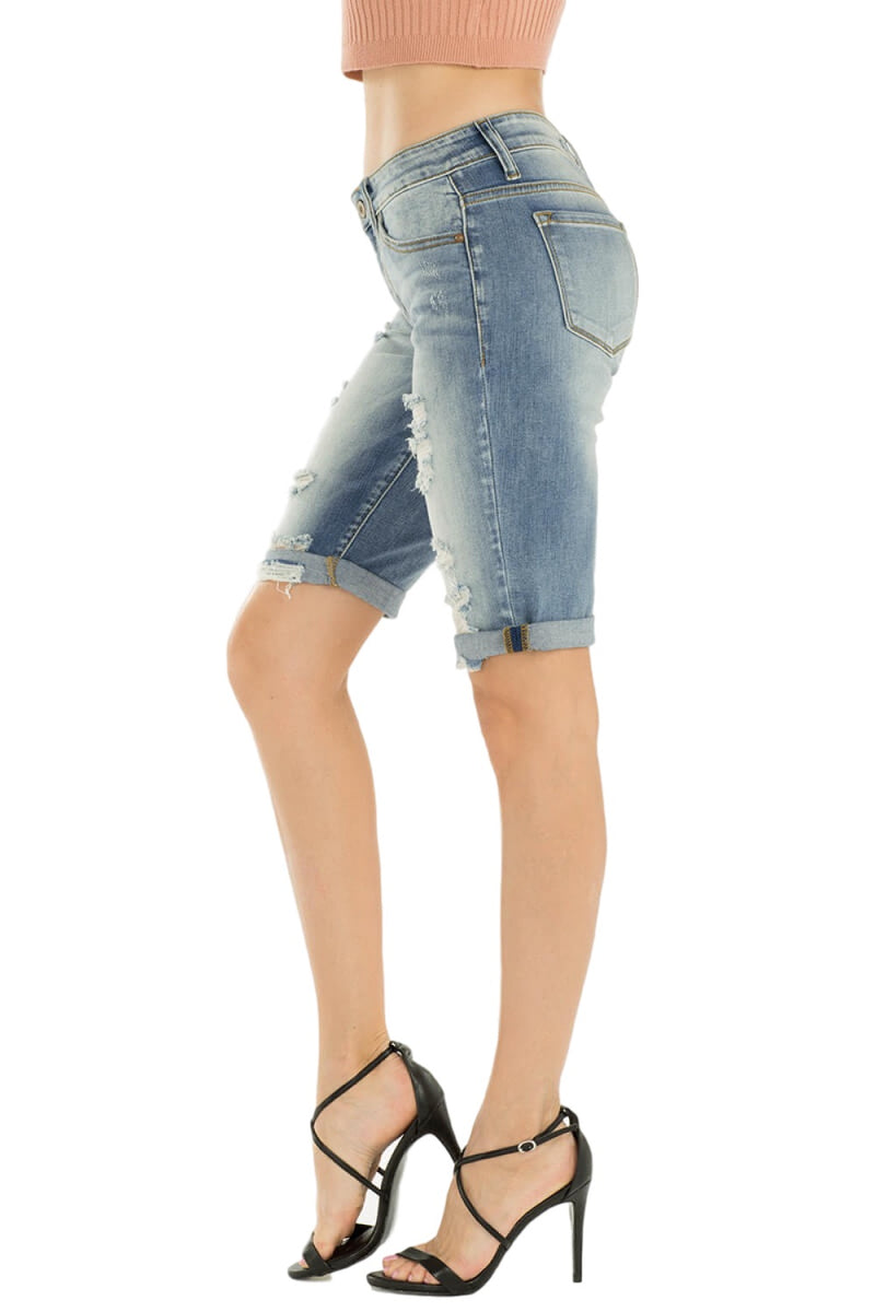 "KanCan Jeans  Collection: February 2019   Style Name: Kevia-Anika  Color: Medium Wash  Cut: Bermuda Shorts  Rise: Mid-Rise  8.5"" RISE / 11"" INSEAM   74% COTTON 15% RAYON 10% POLYESTER 1% SPANDEX  Fly: Zipper   Style #: KC8370L"
