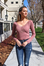 "Feminine and bold, this top will look beautiful on you! Pair this long sleeve u neck top with your favorite high waist jeans and you are ready for anything.  Collection: Spring 2020 Style Name: Lace Deeply V Top Color: Mauve Cut: Long Sleeve henley Material: 76% POLYESTER/20% RAYON/4% SPANDEX Style #: HUT7368-B8 Contact us for any additional measurements or sizing.  Mckenna is 5'10"" and 122 pounds. She wears a size small top, a 3 in jeans and a size 8.5 in shoes. She is wearing a size small in this top."