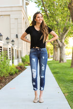 "Kan Can Jeans  Collection: Core Collection Color: Medium Dark Wash Cut: Ankle Skinny, 27"" Inseam Rise: Mid-Rise, 8.5"" Front Rise 98% Cotton 2% Elastane Fly: Zipper  Style #: KC5072M  Contact us for any additional measurements or sizing."