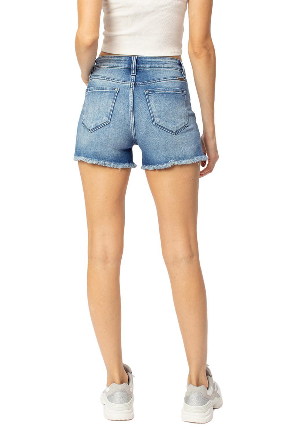 "Frayed High Rise Shorts  By Kan Can  Collection: Spring 2020 Frayed Hem Shorts High Rise waist, 9.5"" Front Rise Shorts, 3.5"" Inseam Medium Wash Material: 93% COTTON, 5% POLYESTER, 2% SPANDEX Stitching: Classic Fly: Zipper Style #: KC9212M  Contact us for any additional measurements or sizing.  True to size per manufacture standard  Kan Can  Size Guide: X-Small= 24/0 Small = 25/3 Medium = 26/5-27/7 Large = 28/9 X-Large 29/11-30/13"