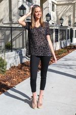 You know you have a wild side... let it show! Pair this deep u neck top with your favorite denim for a flirty look.   Collection: Spring 2020 Style Name: Leopard Hacci Top Color: Charcoal Cut: Short Sleeve Material: 100% Rayon Style #: BT1421-17 Contact us for any additional measurements or sizing.