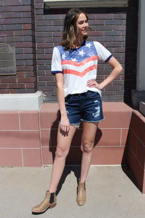 "Be patriotic all summer long! Pair this cute americana t-shirt with your favorite shorts for a fun casual look.   Collection: Spring 2020 Style Name: American Honey Color: White Cut: Short Sleeve Material: 87% Poly 10% Rayon 3% Spandex Style #: BT1042 Contact us for any additional measurements or sizing.  Mckenna is 5'10"" and 122 pounds. She wears a size small top, a 3 in jeans and a size 8.5 in shoes. She is wearing a size small in this top."