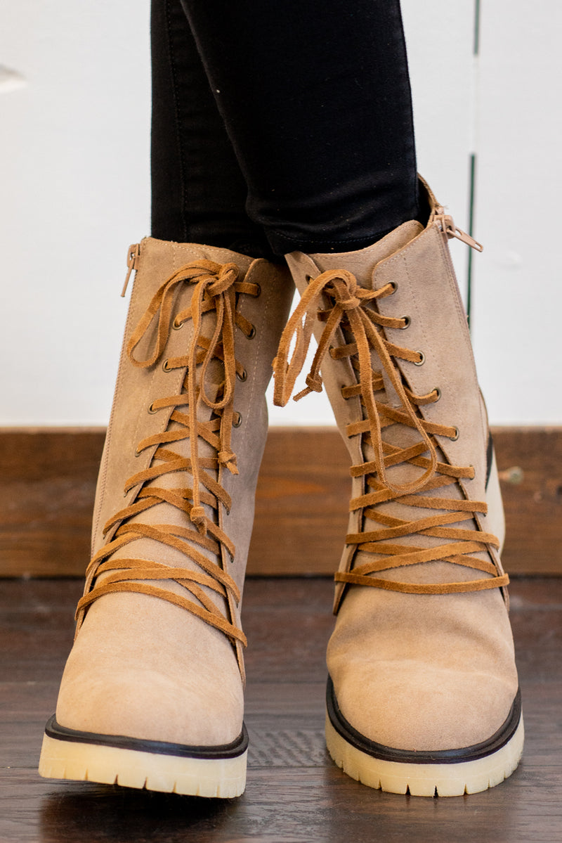 "Boots by Mi.iM  LEATHER LACES DISTINGUISH THIS STYLE FROM THE CLASSIC MILITARY BOOT —while a chunky treaded platform heel makes every step a statement. Fitted with our signature padded footbed, they're a must for all day comfort with wear. Man-made Upper Color: Latte Padded footbed Shaft Height: 2.5"" Contact us for any additional measurements or sizing."