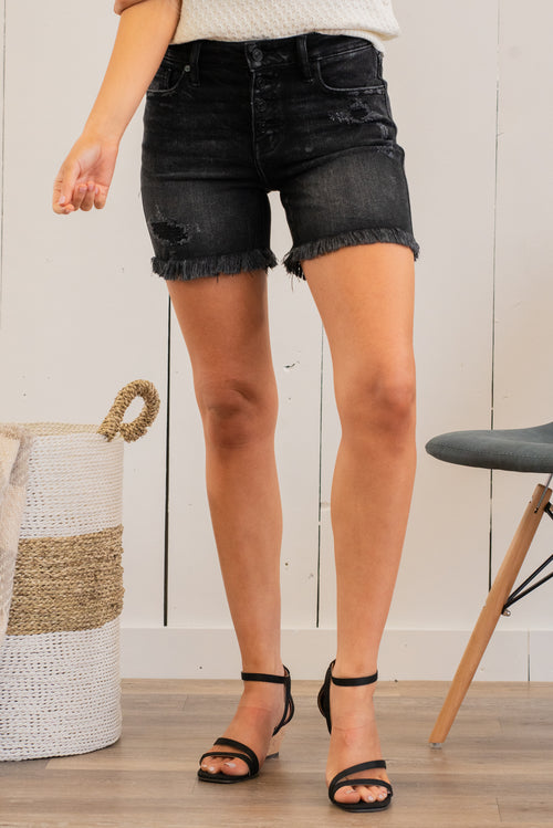 "KanCan Jeans Collection: Spring 2021 Color: Black Grey Cut: Shorts, 5"" Inseam Rise: Mid Rise, 9.25"" Front Rise COTTON 94.9% POLYESTER 3.8% SPANDEX 1.3% Stitching: Classic Fly: Zipper Style #: KC7334DG Contact us for any additional measurements or sizing.  Haley wears a size small top, a 25 in jeans and a small in tops. She is wearing a size small in these shorts."