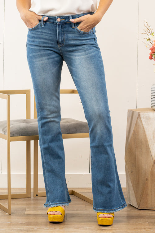 "VERVET by Flying Monkey Jeans    This mid rise flare from VERVET is so fun with its frayed hem. Pair with heels and a blouse for a dressed up outlook. Collection: Spring 2021 Skinny, 34"" Inseam  Rise: Mid Rise, 9"" Front Rise 65% COTTON, 30% POLYESTER, 3% RAYON, 2% SPANDEX Stitching: Classic Fly: Zip Fly Style #: T5073 Contact us for any additional measurements or sizing.  Kristin wears a size small top, a 3 in jeans, and a 7 in shoes. She is wearing a size 26/3 in these jeans."