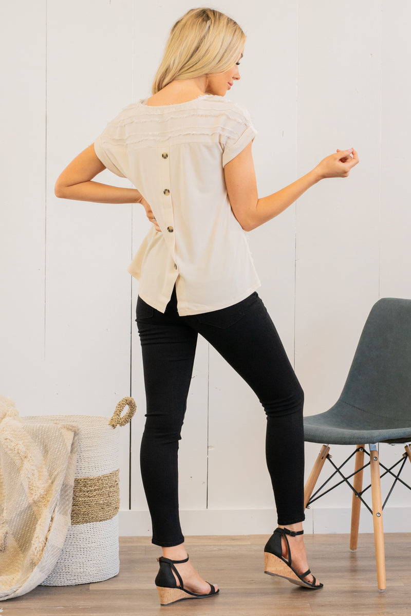 Mine by Blu Pepper  Collection: Winter 2021 Color: Off White Woven Round Neck Short Sleeve Button Up Back 100% Polyester Style #: TB6215 Contact us for any additional measurements or sizing.  Haley wears a size small top, a 25 in jeans and a small in tops. She is wearing a size small in this top.