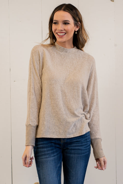 "Hem & Thread   Keep yourself warm and cozy in this dolman sweater top.   Collection: Winter 2020 Color: Oatmeal Neckline: High Neck Sleeve: Long Sleeve SELF: 76% Cotton 23% Rayon 2% Spandex Style #: 30132-Oatmeal Contact us for any additional measurements or sizing.   Mckenna is 5'10"" and 122 pounds. She wears a size small top, a 4 in jeans and a size 8.5 in shoes. She is wearing a size small in this top."