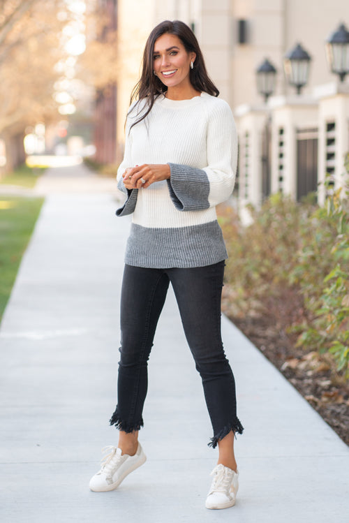 "Miss Sparkling  This bell sleeve sweater paired with your favorite black pair of denim to dress up or lounge around in.  Collection: Winter 2020 Color: White, Grey Neckline: Round Sleeve: Long Sleeve 85% acrylic 15% polyester Style #: O205047 Contact us for any additional measurements or sizing.  Chloe is 5'8"" and 130 pounds. She wears a size 26 in jeans, a small top and 8.5 in shoes. She is wearing a size small in this sweater."