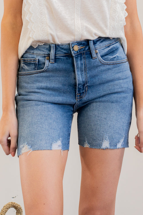 "JBD by Just USA Jeans  Color: Medium Blue Cut: Shorts, 5"" Inseam High Rise, 10"" Front Rise   Stitching: Classic 95% Cotton 4% Polyester 1% Spandex Fly: Zipper Style #: DH615-MD Mckenna is 5'10"" and 122 pounds. She wears a size small top, a 4 in jeans and a size 8.5 in shoes. She is wearing a size small in these shorts."