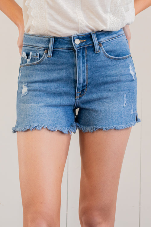 "JBD by Just USA Jeans  Color: Medium Blue Cut: Shorts, 3.5"" Inseam High Rise, 10"" Front Rise   Stitching: Classic 93% Cotton 5% Polyester 2% Spandex Fly: Zipper Style #: DH616-MD Mckenna is 5'10"" and 122 pounds. She wears a size small top, a 4 in jeans and a size 8.5 in shoes. She is wearing a size small in these shorts."
