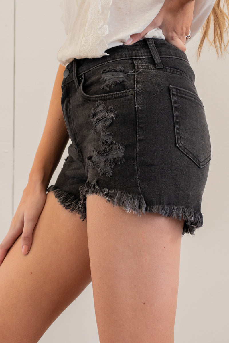 "Just USA Jeans  Color: Washed Black Cut: Shorts, 3"" Inseam High Rise, 11"" Front Rise   Stitching: Classic 96% Cotton 3% Polyester 1% Spandex Fly: Zipper Style #: JH212-BK Contact us for any additional measurements or sizing.   Mckenna is 5'10"" and 122 pounds. She wears a size small top, a 4 in jeans and a size 8.5 in shoes. She is wearing a size small in these shorts."