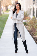 "Miss Sparkling  Stay cozy this winter and dress up your denim with this oversized cardi.   Collection: Winter 2020 Color: Grey Neckline: Open Neck Sleeve: Long Sleeve 42% acrylic 28% polyamide 30% polyester Style #: O205028-Grey  Contact us for any additional measurements or sizing.  Chloe is 5'8"" and 130 pounds. She wears a size 26 in jeans, a small top and 8.5 in shoes. She is wearing a size small in this cardigan."