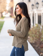 "Miss Sparkling  This waffle knit white top is oversized in a good way! Pair with your favorite jeans and you have a cozy and cute look.  Collection: Winter 2020 Color: Olive Green Neckline: V Neck Sleeve: Long Sleeve 100%Polyester Style #: O205073 Contact us for any additional measurements or sizing.  Chloe is 5'8"" and 130 pounds. She wears a size 26 in jeans, a small top and 8.5 in shoes. She is wearing a 4 in these jeans."
