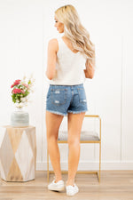 "Just USA Jeans  Color: Medium Blue Cut: Shorts, 3"" Inseam High Rise, 11"" Front Rise Stitching: Classic 100% Cotton Fly: Exposed Button Fly Style #: JH208N-MD Contact us for any additional measurements or sizing.  Haley wears a size small top, a 25 in jeans and a small in tops. She is wearing a size small in these shorts."