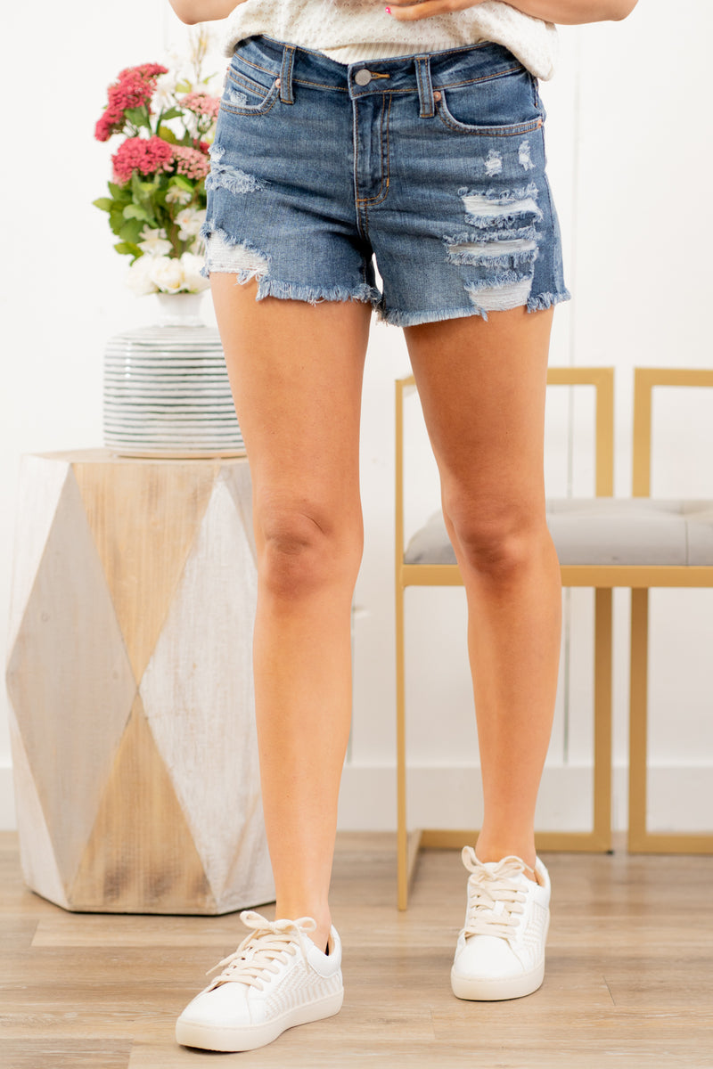 "Just USA Jeans  Color: Medium Blue Cut: Shorts, 3.5"" Inseam Mid Rise, 9"" Front Rise   Stitching: Classic 98% Cotton 2% Elastane Fly: Zipper Style #: JH205-MD Contact us for any additional measurements or sizing.  Haley wears a size small top, a 25 in jeans and a small in tops. She is wearing a size small in these shorts."
