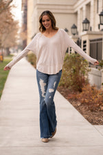 "Blu Pepper  A comfortable and versatile top to pair with denim and stay cute & cozy.  Collection: Winter 2020 Color: Oatmeal  Neckline: Round Sleeve: Long Sleeve, banded cuffs 95%Rayon 5%Spandex Style #: D9ST1015 Contact us for any additional measurements or sizing.  Mckenna is 5'10"" and 122 pounds. She wears a size small top, a 4 in jeans and a size 8.5 in shoes. She is wearing a size small in this top."