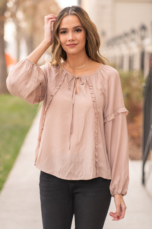 "Mine by Blu Pepper  Wear this cute blouse to dress up your favorite denim.  Collection: Winter 2020 Color: Khaki Satin Top Keyhole Neckline Raglan Sleeve with Ruffle 70% Rayon 30% Polyester  Style #: EM6467-Khaki Contact us for any additional measurements or sizing.  Mckenna is 5'10"" and 122 pounds. She wears a size small top, a 4 in jeans and a size 8.5 in shoes. She is wearing a size small in this top."