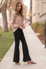"Judy Blue Collection: Fall 2020 Color: Black Wash Cut: Super Flare Bell Bottoms, 32"" Inseam Rise: High Rise, 10"" Front Rise  Super Stretch Material 59% RAYON 23% COTTON 17% POLYESTER 1% SPANDEX Machine Wash Separately In Cold Water Stitching: Classic Fly: Zipper Style #: JB8396 , 8396 Contact us for any additional measurements or sizing.  Mckenna is 5'10"" and 122 pounds. She wears a size small top, a 4 in jeans and a size 8.5 in shoes. She is wearing a size 26 in these jeans."