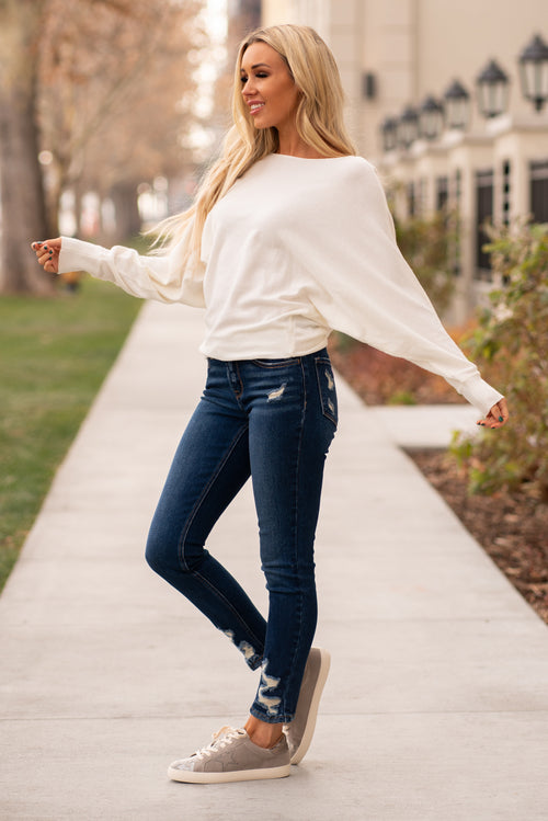 Hem & Thread   Extenuate your waist with this ivory white dolman sweater.   Collection: Winter 2020 Color: Ivory White Neckline: Boatneck  Sleeve: Long Sleeve SELF: -57.3%ACRYLIC 29.3%POLYESTER 13.4%NYLON Style #: 30102-IvoryWhite Contact us for any additional measurements or sizing.  Haley wears a size small top, a 25 in jeans and a small in tops. She is wearing a size small in this top.