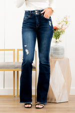 "KanCan Jeans  Collection: Spring 2021 Color: Dark Wash Cut: Flare, 34"" Inseam  Rise: High Rise, 10.5"" Front Rise COTTON 94.9% POLYESTER 3.8% SPANDEX 1.3% Fly: Zipper Style #: KC7344D Contact us for any additional measurements or sizing.  Chloe is 5'8"" and 130 pounds. She wears a size 3 in jeans, a small top, and 8.5 in shoes. She is wearing a size 25/3 in these jeans."