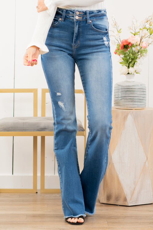 "KanCan Jeans  Collection: Spring 2021 Color: Medium Wash Cut: Flare, 34"" Inseam  Rise: High Rise, 10.5"" Front Rise COTTON 94.9% POLYESTER 3.8% SPANDEX 1.3% Fly: Zipper Style #: KC7344M Contact us for any additional measurements or sizing.  Haley wears a size small top, a 1 in jeans, and a small in tops. She is wearing a size 25 in these jeans."